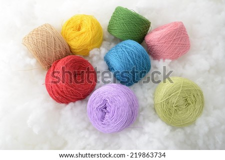 Colorful threads, Ball Cotton yarn on white fabric - stock photo