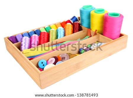 Colorful threads for needlework in wooden box isolated on white