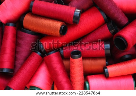 colorful threads in red tone - stock photo