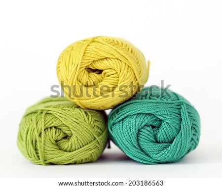 Colorful threads on a white background