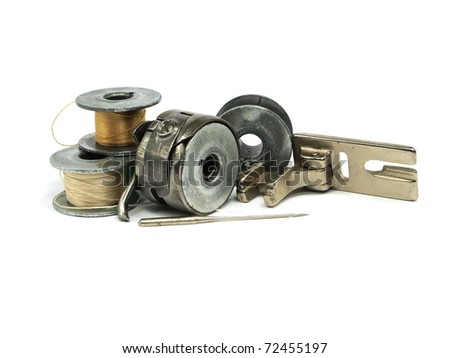 Colorful threads vintage spools and sewing machine items on a white background - stock photo