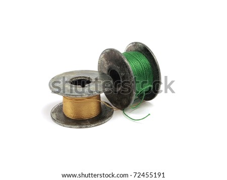 Colorful threads vintage spools on white background