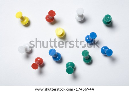 Colorful thumb tacks on a white background