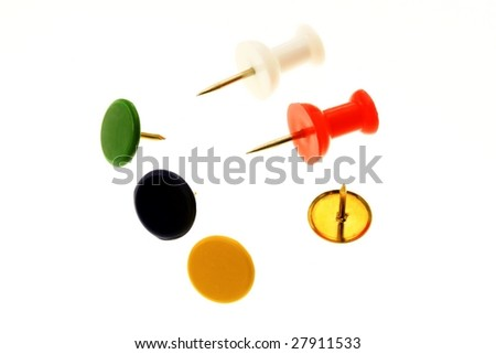 Colorful thumb tacks on a white background - stock photo