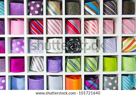 Colorful tie collection in the men's shop - stock photo