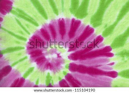 Colorful tie dye fabric with spiral circle pattern - stock photo