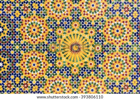 Colorful tile pattern (zellige) from the mosque wall in Casablanca, Morocco. Zellige is terra cotta tilework covered with enamel in the form of chips set into plaster.