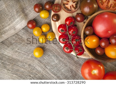 colorful tomatoes on textile background. top view