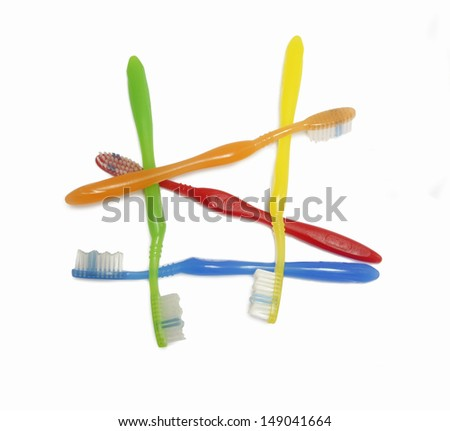 colorful toothbrush disheveled on withe background