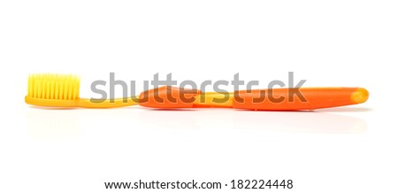 colorful toothbrushes on white background