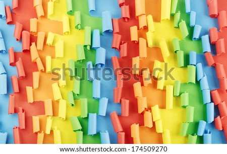 Colorful torn sheets of paper in rainbow colors - stock photo