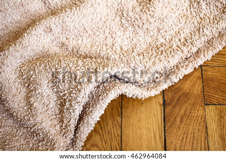 Colorful towel on wooden background: brown color. Close up composition on Wooden panels floor horizontal photo