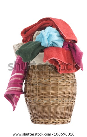 colorful towels in a basket isolated on white background