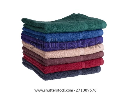 Colorful towels on a white background - stock photo
