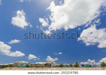 Colorful town houses along the beach on a tropical island - stock photo