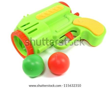 Colorful toy gun with plastic balls on white background - stock photo
