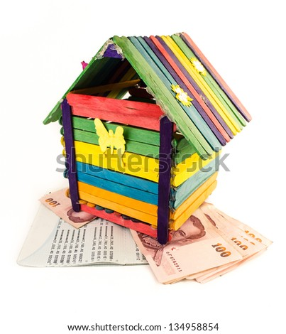 colorful toy house and bank account book isolated on white background