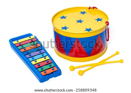 Colorful toy metal drum and xylophone in bright colors for preschool isolated on white