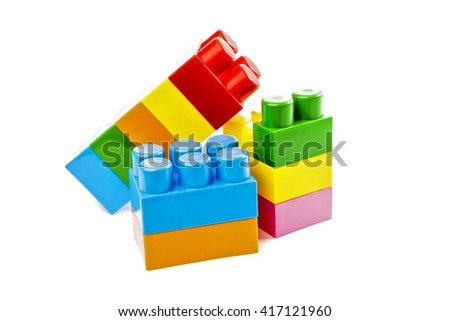 Colorful  toy plastic building blocks isolated on white background - stock photo