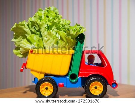 Colorful Toy Truck with lettuce - stock photo