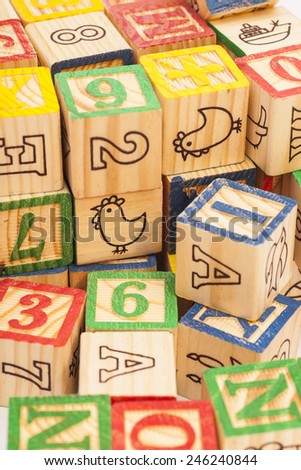colorful toy wooden block letters - stock photo