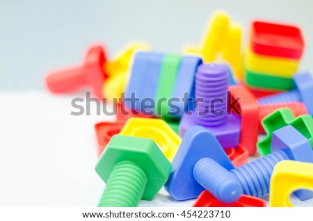 Colorful toys bolts and nut with blurry effect for wallpaper. Blur background.