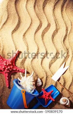 colorful toys for childrens sandboxes against the beach sand background/summer beach holidays background - stock photo