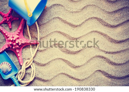 colorful toys for childrens sandboxes against the beach sand background/summer holidays background - stock photo