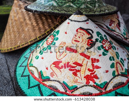 Colorful traditional conical hat with a special design sold at a small shop in Bali, Indonesia