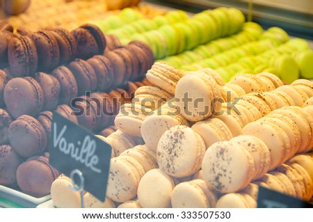 Colorful traditional french sweets macarons in a shop - stock photo