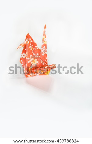 Colorful traditional Japanese origami crane in side view with space for text - stock photo
