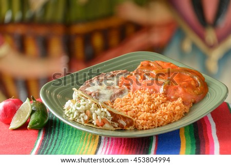 Colorful Traditional Mexican food dishes chicken and tacos - stock photo
