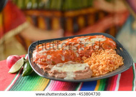 Colorful Traditional Mexican food dishes chicken rojo - stock photo