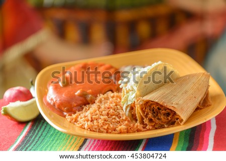 Colorful Traditional Mexican food dishes tamales and chicken - stock photo
