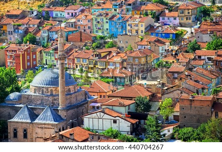 Colorful traditional ottoman houses and a mosque in the old town center of Afyon, Turkey