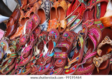Colorful traditional shoes for sale in Jodhpur, Rajasthan, India - stock photo