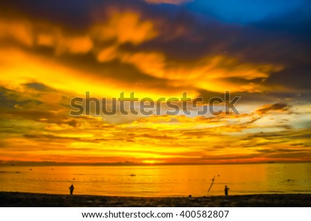 Colorful tropical beach at sunset. Abstract blurred background