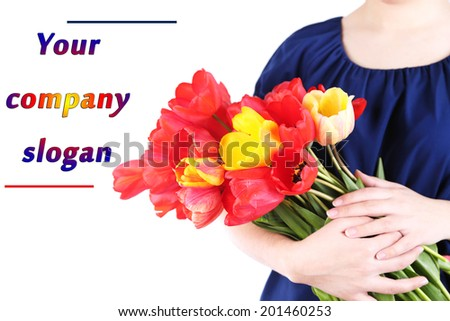 Colorful tulips in female hands isolated on white