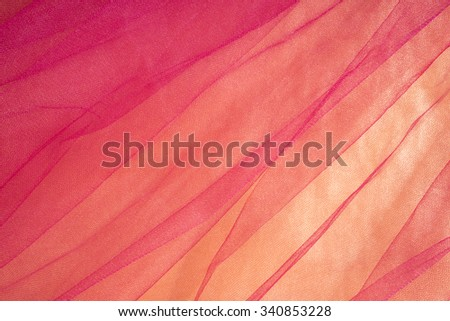 Colorful Tulle on Satin Fabric Background - stock photo