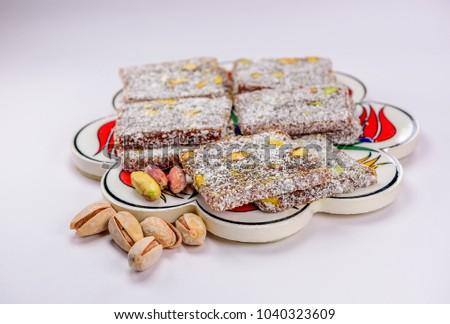 Wonderful Traditional Eid Al-Fitr Feast - stock-photo-colorful-turkish-delight-lokum-with-nuts-on-plate-a-traditional-eid-al-fitr-sweet-1040323609  Image_104270 .jpg