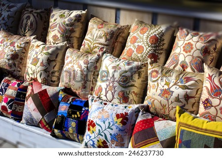 Colorful Turkish design cushions at Grand Bazaar in Istanbul, Turkey - stock photo