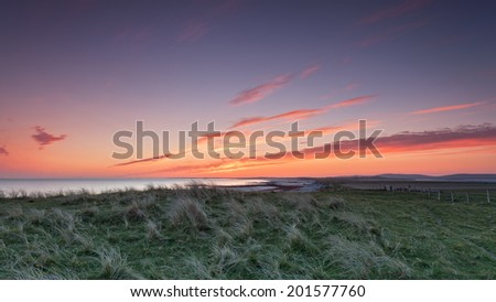 Colorful twilight panorama on Baleshare, Outer Hebrides of Scotland . Baleshare is a flat tidal island linked to North Uist by a causeway .