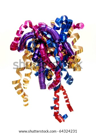 Colorful twirled New Year's Eve ribbon - stock photo