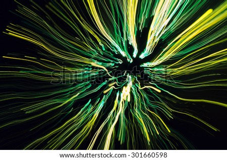 Colorful twirling lines in dark - stock photo