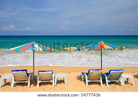 Colorful Umbrella and chair on the beach