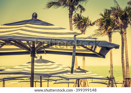 Colorful umbrella beach on sky background - Vintage Filter