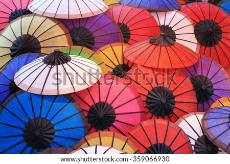 Colorful umbrella in the city of Luang Prabang, Laos. - stock photo