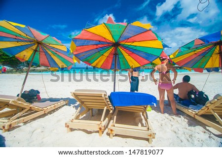 Colorful umbrella on the beach with tourist, Phuket Thailand