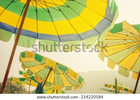 Colorful Umbrellas Beach at sunny summer day on island Phuket Thailand, toned - stock photo