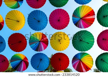 colorful umbrellas disclosed rows on sky background - stock photo